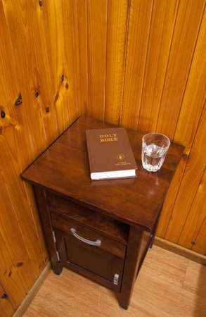 side table: bible on bed side table Stock Photo