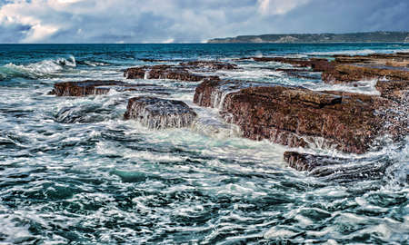 resilient: waves on rocks at the coast