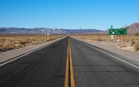 long highway through desert photo