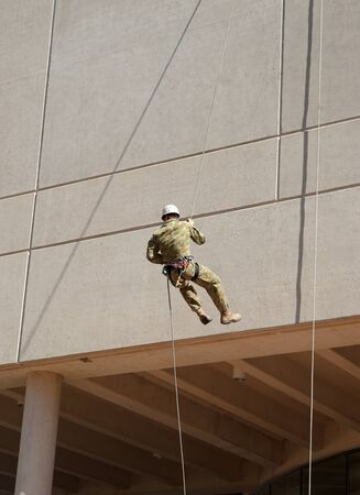 abseil: abseiling down the wall