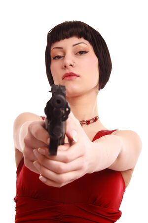 red dressed girl with revolver isolated on white photo
