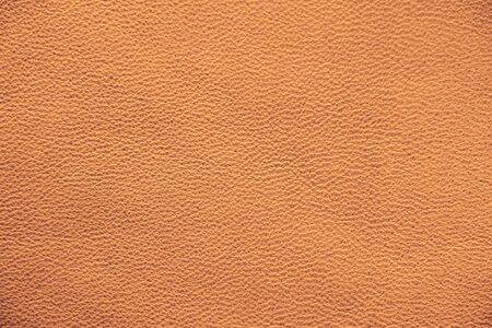 Texture of genuine leather. Brown background. Chocolate and coffee shade of leather material.