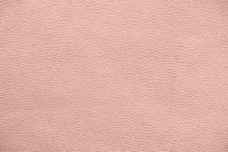 The texture of genuine leather. Pink background.