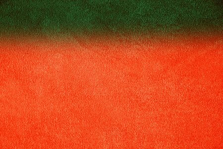 Texture of natural red and green suede