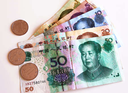 Chinese yuan money. Banknotes and metal coins of different denominations.