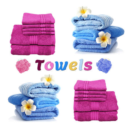 Blue and purple clean ironed terry towels stacked neatly against a white background. Standard-Bild