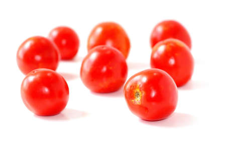 Red natural tomatoes isolated on white background.