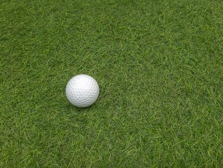 golf ball on the putting  artificial grass green.