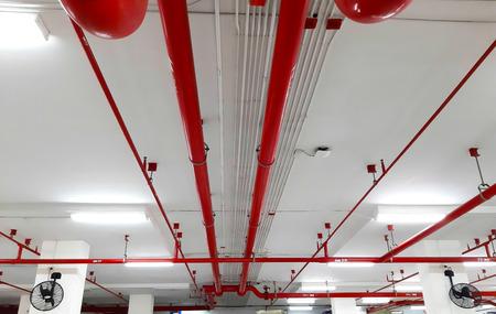 Red pipeline extinguishing water in building