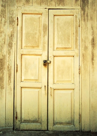 Old door with gray paint that has weathered into a remarkable texture                           photo