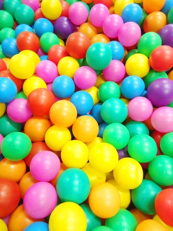 Background, colorful plastic balls on children photo