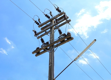 Electricity post in blue sky photo