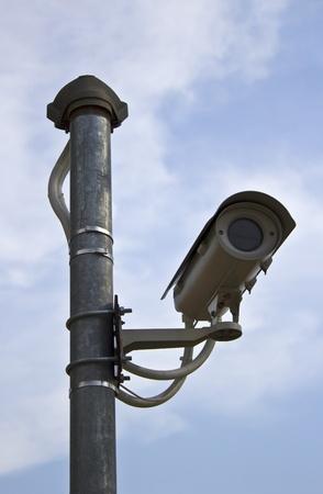 Surveillance Security Camera or CCTV on blue sky Stock Photo - 13555505