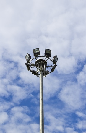 Spot-light tower in blue sky with cloud Stock Photo - 13555490