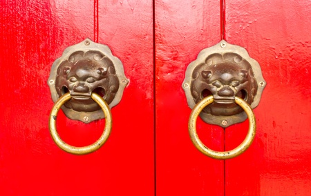 Red chinese door with a lion dragon head  photo