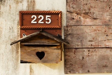 A mail box on Concrete and wooden walls photo