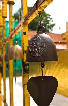 bedeck: A small bell hanging in the temple