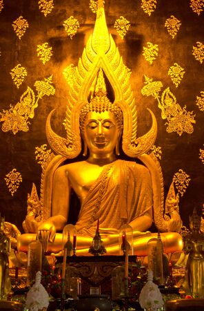Golden buddha statue image in Phare Temple Thailand photo