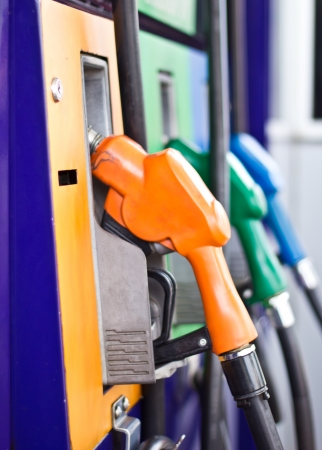 Colorful fuel oil gasoline dispenser at petrol filling station photo