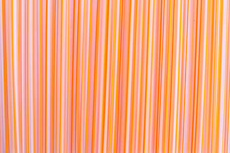 Colored drinking straws background photo