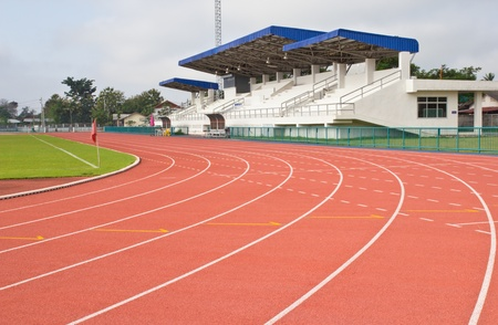 Stadium track and field area empty on a sunny day photo