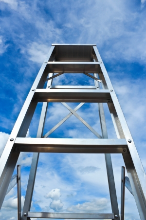 Stainless steel ladder and blue sky photo