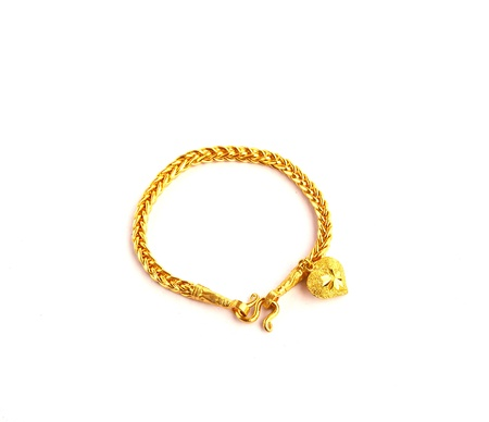 Golden bracelet with heart shape the image isolated on white photo