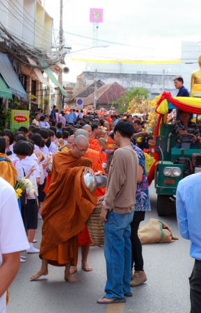Phrae,Thailand - October 31,2012 : Unidentified Buddhist monks is given food offering from people at the morning on End of Buddhist Lent Day. on october 31, 2011 in Muang, Phrae, Thailand.