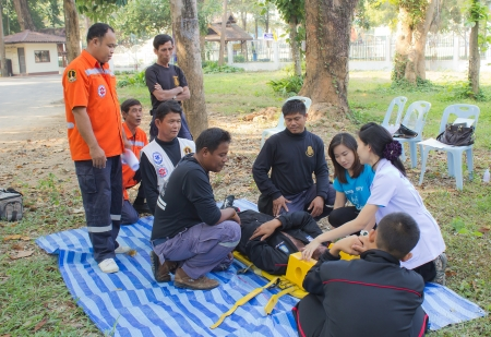 l first: PHRAE,THAILAND - DECEMBER 20 : Unidentified  men are first aid training from staff  the hospital on  December 20, 2012 at local parks, Muang, Phrae, Thailand. Editorial