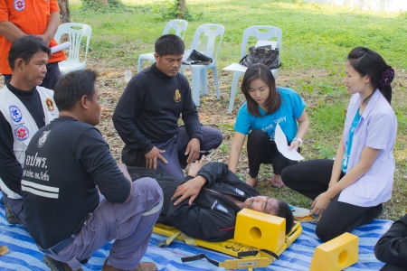 PHRAE,THAILAND - DECEMBER 20 : Unidentified  men are first aid training from staff  the hospital on  December 20, 2012 at local parks, Muang, Phrae, Thailand.