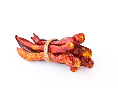Dried chili peppers isolated on white background photo