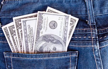 American dollar bills in jeans pocket background photo