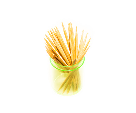 toothpick: Isolated bamboo toothpick in a bottle isolated on white background