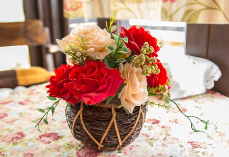 beautiful bouquet of bright flowers in basket on table photo