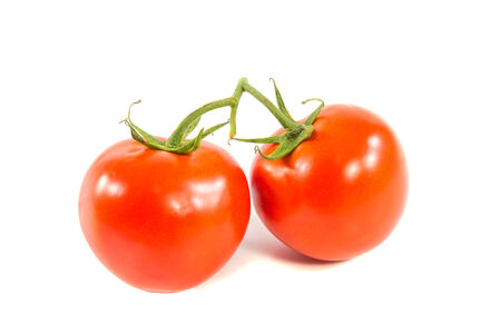 Two fresh red tomato isolated on white background