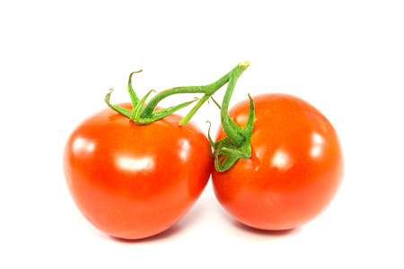 Two fresh red tomato isolated on white