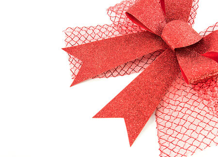 Closeup red bow isolated on white  photo