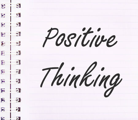 Positive thinking concept text on notebook photo