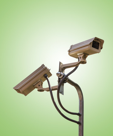 Security camera CCTV video surveillance on green background photo