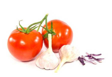 Fresh red tomato and garlic isolated on white background Stock Photo