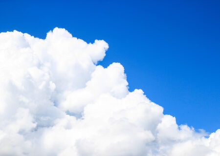 cloudscape with white clouds and blue sky