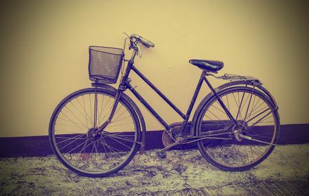 Vintage Bicycle Against Grunge Wall photo