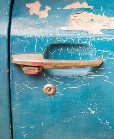 Close up of old rusty car door photo