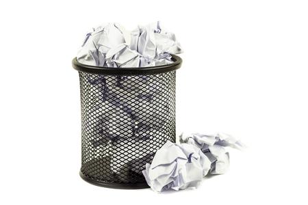 wastepaper basket: Close up Overflowed wastepaper basket on white background