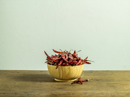 Red dried chili peppers in wooden cup on the table Stok Fotoğraf