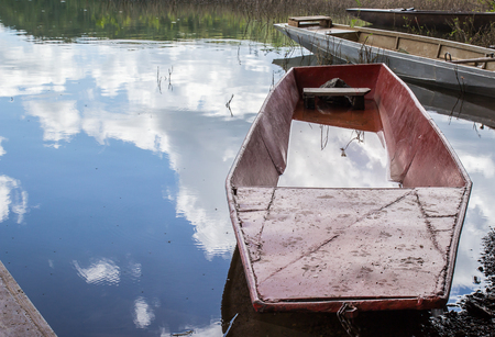 lipno: Old fishing boat on a lake shore