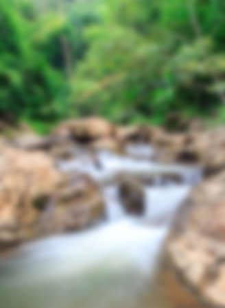 Blur background with water fall in the nature