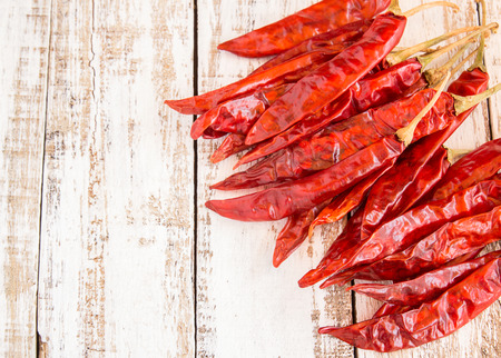 chili peppers: Dried chili peppers on white wooden background