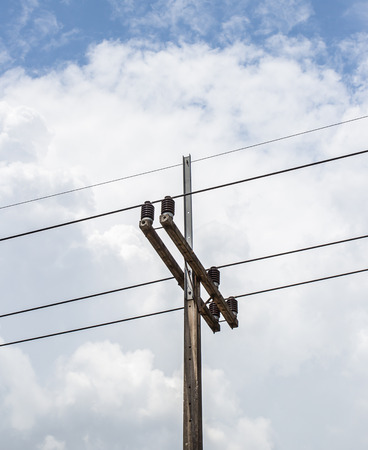 metal grid: Electricity post in blue sky and clouds background