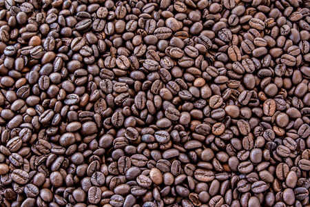Close up coffee beans background and texture photo
